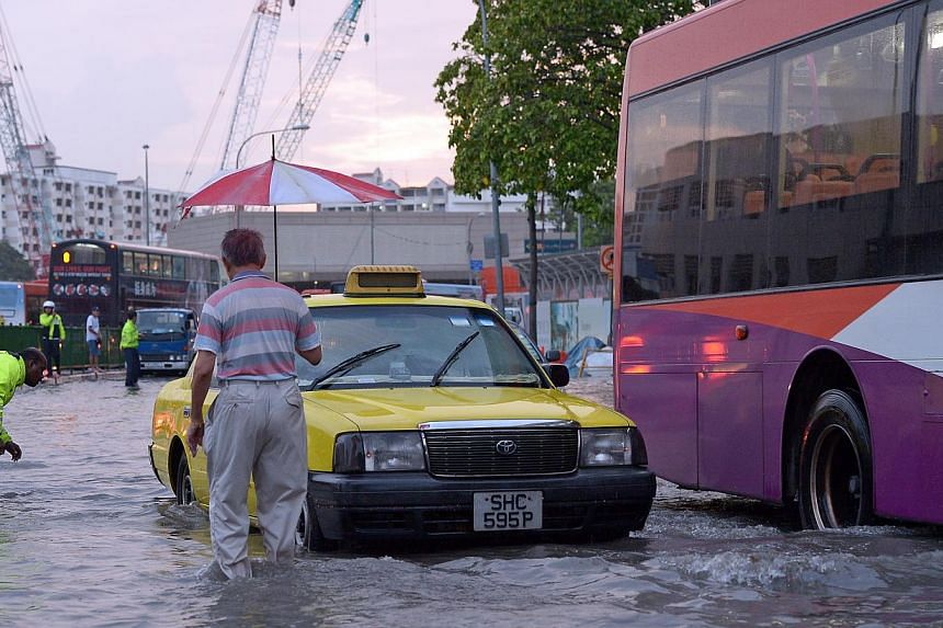Heavy rains on Oct 20, 2013, afternoon left some vehicles stranded in ankle-deep flood waters in Ubi Avenue 2. PUB says Singapore has the infrastructure in place to minimise disruption from flash floods in the coming north-east monsoon season. -