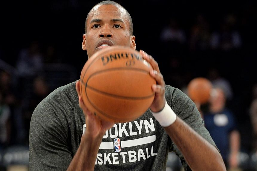 In this Feb 23, 2014 file photo, Jason Collins of the Brooklyn Nets warms up prior to the start of the game against the Los Angeles Lakers at Staples Centre in Los Angeles, California. Collins, 35, the NBA's first active openly gay player announced h