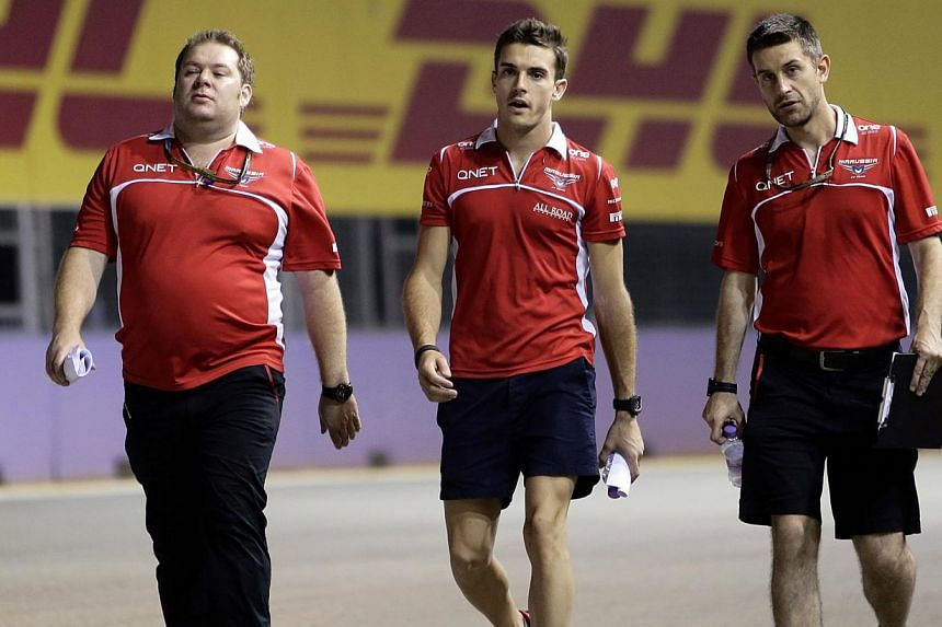 Formula One driver Jules Bianchi of France (centre) and crew members walk on the the Marina Bay street circuit ahead of the Singapore F1 Grand Prix in Singapore Sept 18, 2014. Bianchisuffered the most serious F1 race injury since Ayrton Senna d