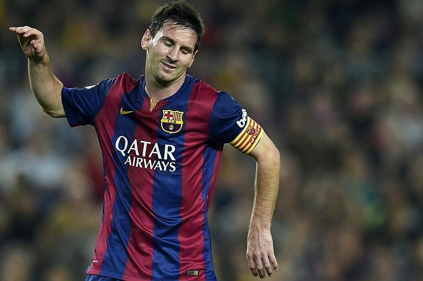 Barcelona's Argentinian forward Lionel Messi reacts during the Spanish league football match FC Barcelona vs RC Celta de Vigo at the Camp Nou stadium in Barcelona on Nov 1, 2014. Messi's father Jorge has sought to play down comments his son made this