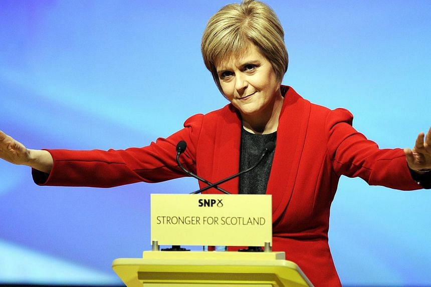 Nicola Sturgeon (above) was named as Scotland's First Minister on Wednesday with a vote in the region's parliament, becoming the first woman to take on the role. -- PHOTO: AFP