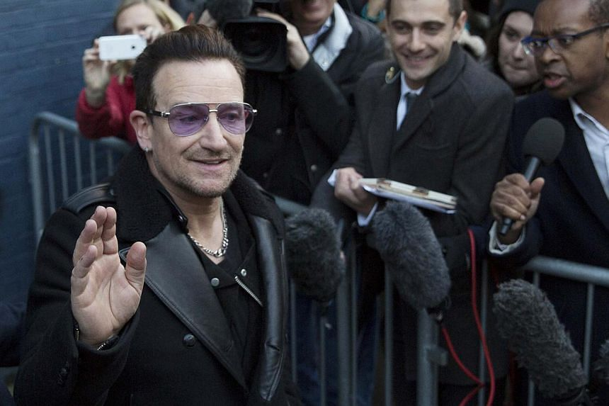 Irish band U2's lead singer, Bono, leaves the recording of the Band Aid 30 charity single in west London Nov 15, 2014. Bono had hours of surgery and needed metal plates to repair fractures of his arm, shoulder blade and face suffered in a cycling acc