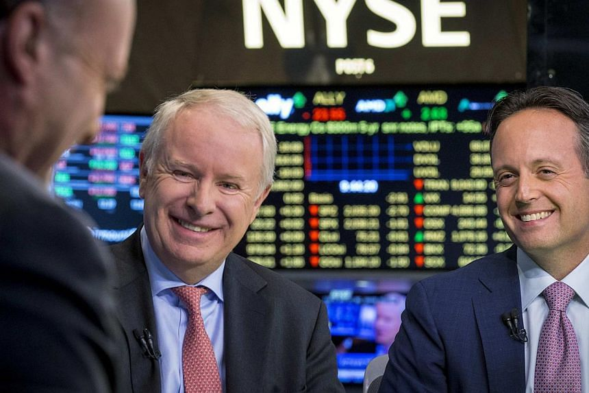 Actavis CEO Brenton Saunders (right) and Allergan CEO David Pyotton (left) are interviewed by CNBC on the floor of the New York Stock Exchange on Nov 17, 2014. Pharmaceutical giant Actavis has said it would pay US$66 billion (S$86 billion) for Allerg