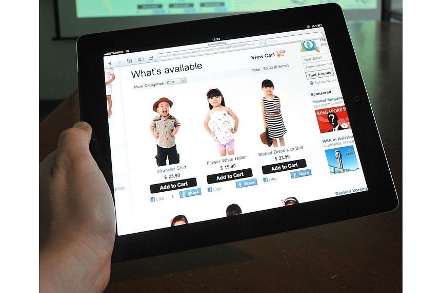 The study shows that 26 per cent of Singaporeans shop online at least once a week. -- PHOTO: ST FILE