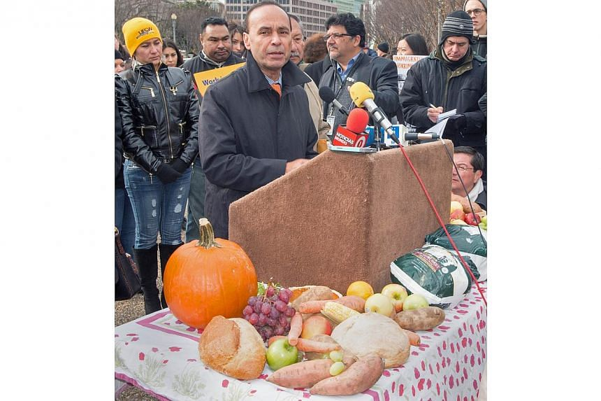 Democrat Representative Luis Gutierrez delivering remarks to the media in Lafayette Park, across the street from the White House, on Nov 19, 2014, reminding Americans about the people who produce the foods for the Thanksgiving meal. Members of United