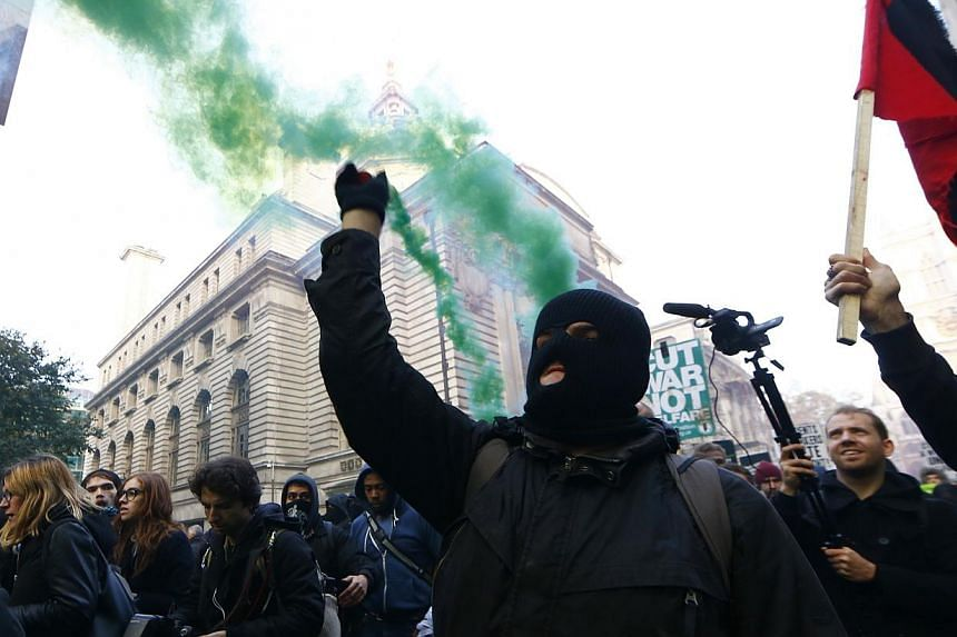 Demonstrators participate in a protest against student loans and in favour of free education, in central London November 19, 2014. Police and protesters clashed as several thousand students took to the streets of central London on Wednesday to rally
