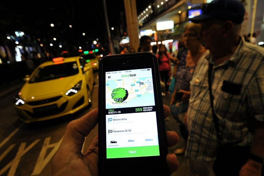 Third-party taxi booking services like GrabTaxi (pictured) and Uber will soon be regulated by the Land Transport Authority (LTA). -- PHOTO: LIM YAOHUI FOR THE STRAITS TIMES