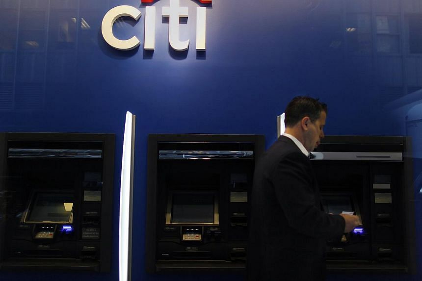 A man walking past a Citibank branch in lower Manhattan, New York in this file photo from Oct 16, 2012. The global head of Citigroup's environmental and social risk management was found dead in his New York apartment on Tuesday with his throat cut an