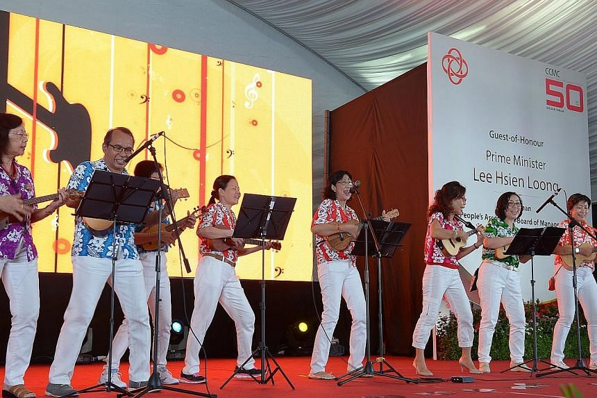 Ukulele group from Bishan North performing on stage at the Community Club Management Committees (CCMCs) Celebrate 50 Years of Nation-building at the CCMC 50th Anniversary Celebrations Dinner at People's Association Headquarters Lawn. -- ST PHOTO: DES