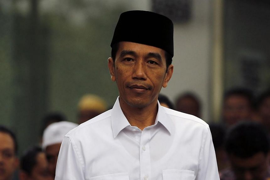 """Indonesian President Joko """"Jokowi"""" Widodo is scheduled to fly to Singapore in an economy-class flight on Friday to attend the graduation ceremony of his youngest son, Kaesang Pangarep. -- PHOTO: REUTERS"""