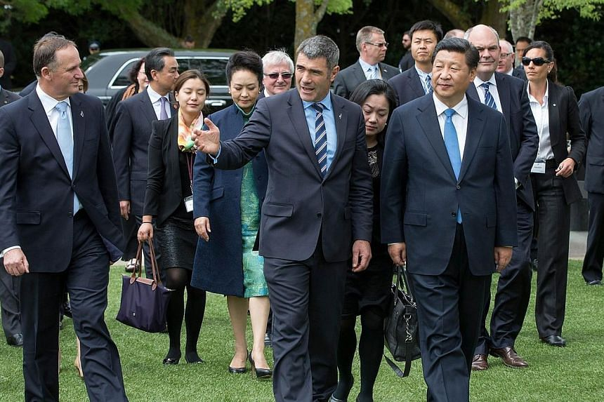 New Zealand Prime Minister John Key (left) and Minister for Primary Industries Nathan Guy (centre) welcome Chinese President Xi Jinping of China (right) to the Karaka Agitech Event in Auckland on Nov 21, 2014. Chinese President Xi Jinping arrive