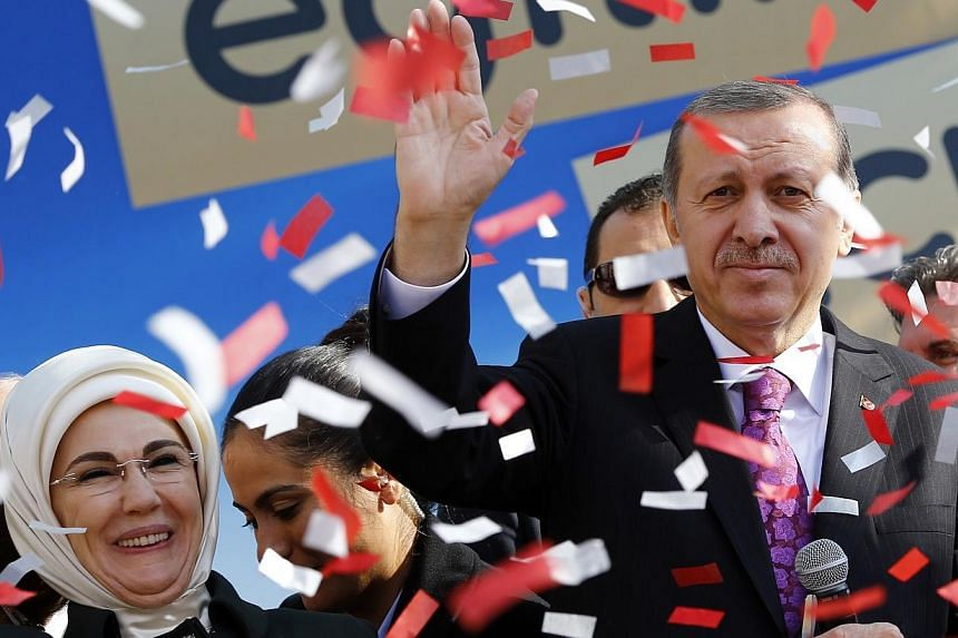 Turkey's President Tayyip Erdogan, accompanied by his wife Emine Erdogan, attends the opening ceremony of an imam-hatip school in Ankara on Nov 18, 2014.Turkey's top religious body said on Friday that there are plans to build a mosque in every