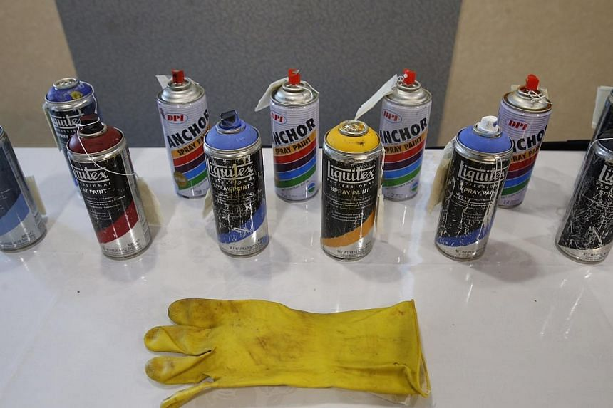 Spray cans and gloves seized from the vandals. -- ST PHOTO: KEVIN LIM