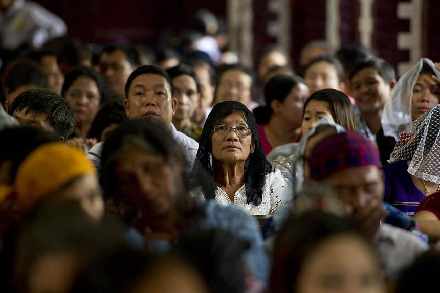 People attend the 500th Jubileee Year of the presence of Catholic Church in Myanmar in Yangon on November 21, 2014.Thousands of Myanmar Catholics marked 500 years of the Church's presence inside the country in a lively celebration at a Yangon c