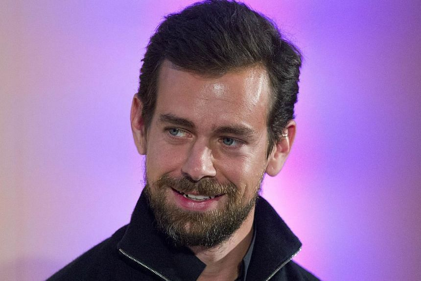 Twitter chairman Jack Dorsey announcing at an event in London on Nov 20, 2014, the launch of Square Register mobile application. The app will allow merchants to track sales, inventories and other data on smartphones and tablets. -- PHOTO: AFP