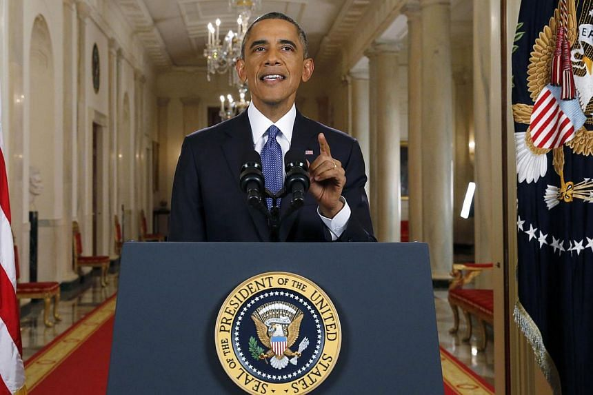 US President Barack Obama announces executive actions on the country's immigration policy during a televised address from the White House on Nov 20, 2014. -- PHOTO: REUTERS