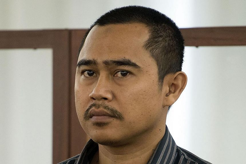 Malaysian diplomate Muhammad Rizalman Ismail, who is charged with attempted rape, stands in the dock at the Wellington District Court on Oct 28, 2014. -- PHOTO: AFP