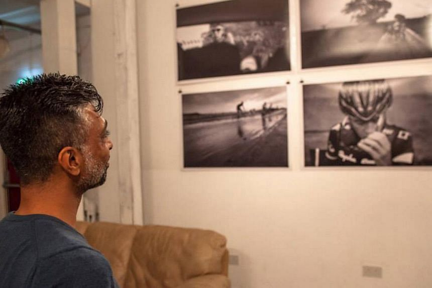 Founder of the Bicycle Film Festival, Mr Brendt Barbur (left) created the event after he was hit by a bus while riding a bicycle. The Bicycle Film Festival in London in October last year had an art show (above), while a crowd in Istanbul watches a mo