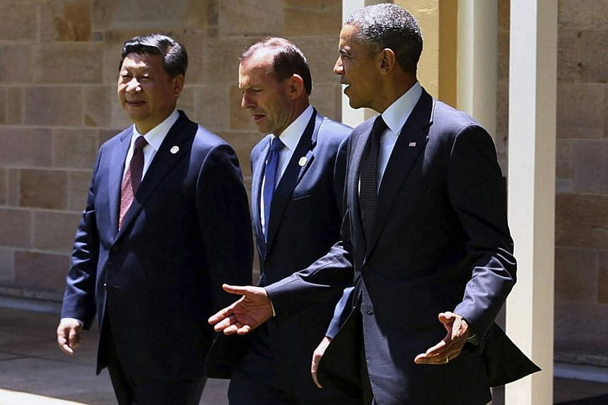 It has been a good week for Chinese President Xi Jinping, but a poor one for his US counterpart Barack Obama, seen here flanking their G-20 summit host, Australian Prime Minister Tony Abbott. Mr Xi offered signs of friendship and evidence of economic