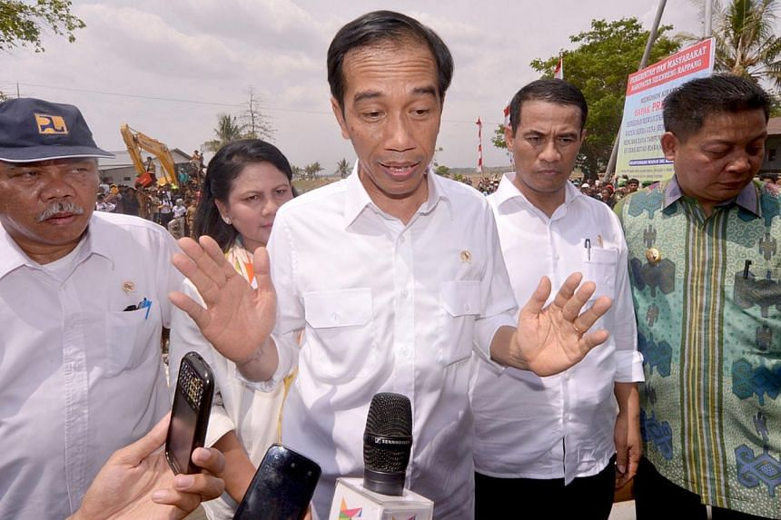 President Joko Widodo speaking to journalists after visiting farmers in a village on southern Sulawesi island. The political and business elite is coming to terms with a president who doesn't know who the main players are, nor care what they think as
