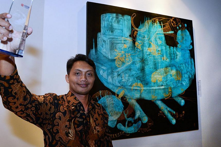 This year's big winner was Indonesian Antonius Subiyanto, 34, who bagged the UOB Painting of the Year (Indonesia) as well as the UOB South-east Asian Painting of the Year award, worth US$10,000 for his acrylic work Old Stock Fresh Menu. -- ST PHOTO: