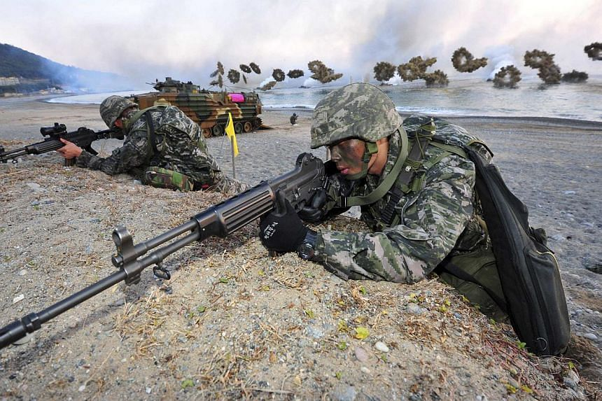 """South Korean Marines take part in a landing operation which is a part of annual military exercise """"Hokuk"""", on a beach in Pohang on Nov 18, 2014. -- PHOTO: REUTERS"""