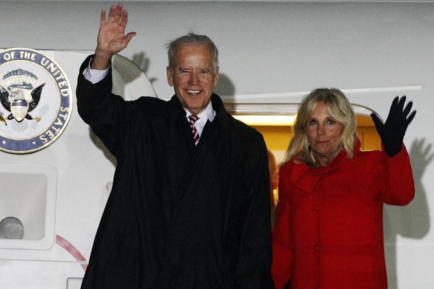 US Vice-President Joe Biden (left) and his wife Jill wave upon their arrival at Boryspil International airport outside Kiev Nov 20, 2014. -- PHOTO: REUTERS