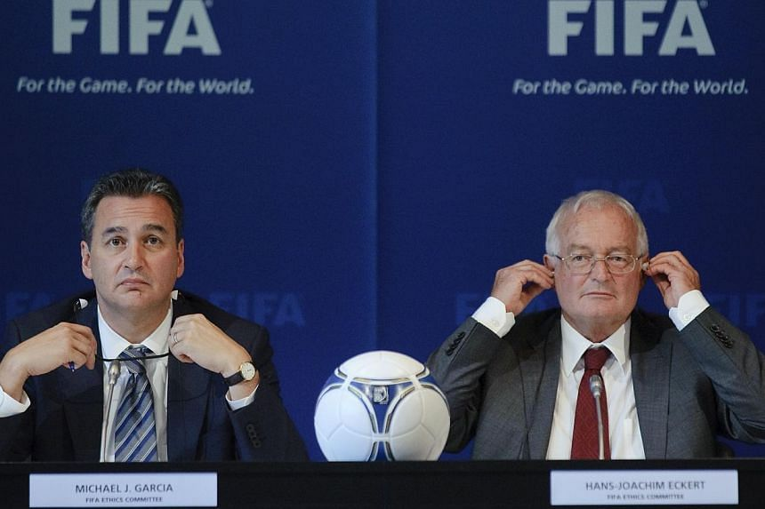 A file picture taken on July 27, 2012, showing chief investigator Michael Garcia (left) and German judge Hans-Joachim Eckert at a media conference at the Fifa headquarters in Zurich. The The two have been at loggerheads over how much of the report on