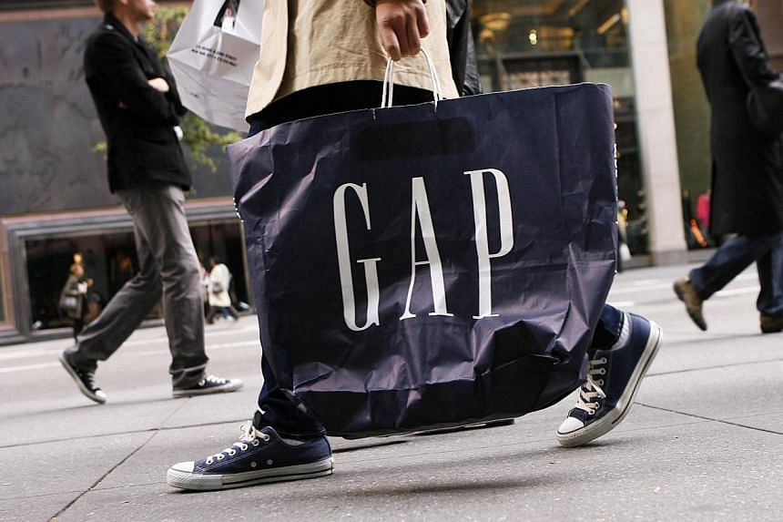 Apparel retailer Gap cut its full-year earnings forecast as sales at the Gap brand continued to fall and demand for the cheaper Old Navy clothing slowed. -- PHOTO: REUTERS