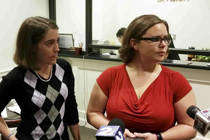 Jennifer Rose, (left), a county government employee and Sara Meadows, a teacher, filing a marriage licence application in Charleston, South Carolina on Oct 9, 2014.The US Supreme Court on Thursday denied a request to block gay marriage from pro