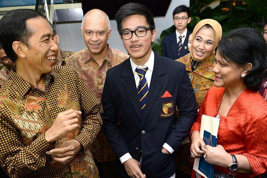 (From left) President Joko Widodo, Indonesia ambassador to Singapore Andri Hadi, Mr Joko's son Kaesang Pangarep, the ambassador's wife and First Lady Iriana Widodo. -- ST PHOTO:LIM SIN THAI