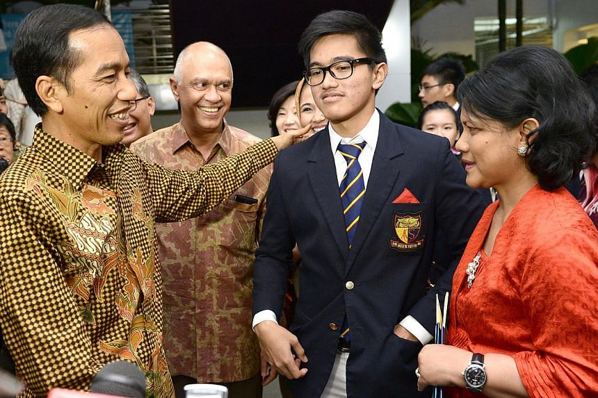 President Joko Widodo (left), Indonesia ambassador to Singapore Andri Hadi, Mr Joko's son Kaesang Pangarep and First Lady Iriana Widodo after they attended the graduation of their younger son at Anglo-Chinese School on Nov 21, 2014. -- ST PHOTO: LIM