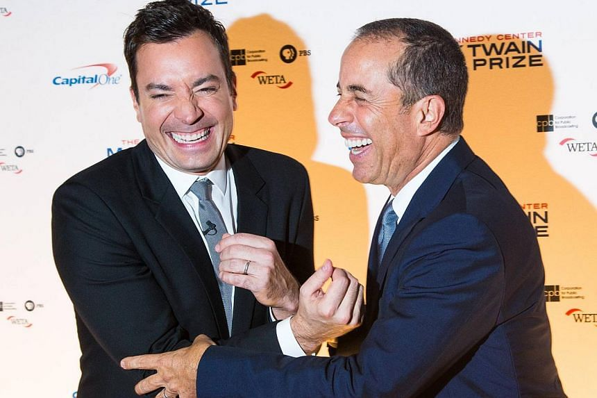 Comedians Jimmy Fallon (left) and Jerry Seinfeld laugh together at an event in Washington Oct 19, 2014. Veteran US comedian Jerry Seinfeld is not autistic, he said in comments reported Thursday, two weeks after he'd suggested he was on the autism spe