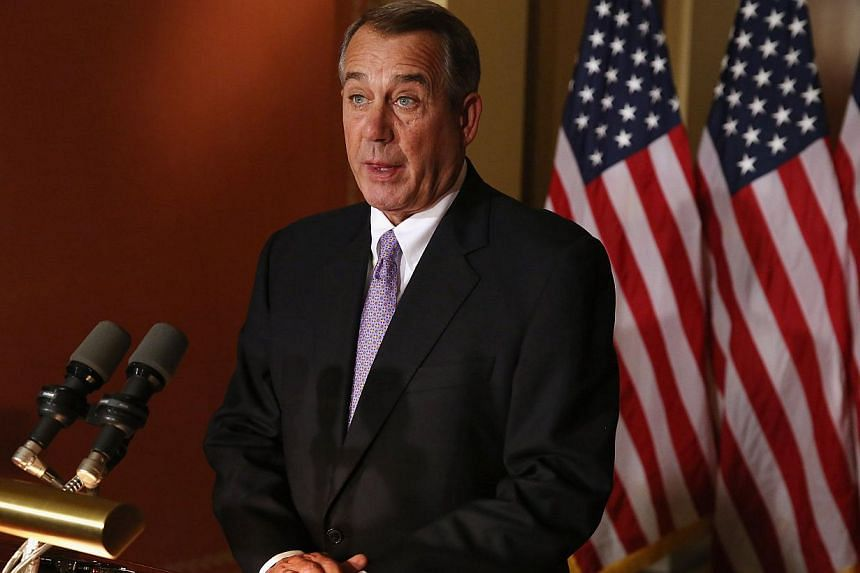 Speaker of the House John Boehner talks with reporters at his office in the US Capitol Nov 21, 2014 in Washington, DC. Boehner said on Friday that President Barack Obama's executive action on immigration has sabotaged chances for bipartisan legi