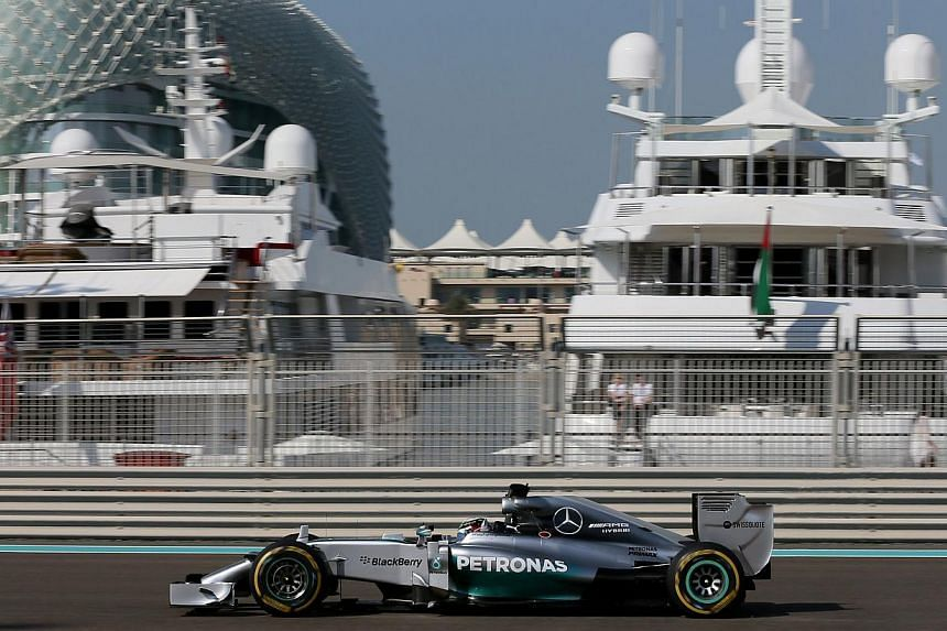 British driver Lewis Hamilton on the track for the first practice session at the Yas Marina circuit in Abu Dhabi on Nov 21, 2014. World championship leader Hamilton turned the screw to emphasise his superiority when he topped the times again ahead of