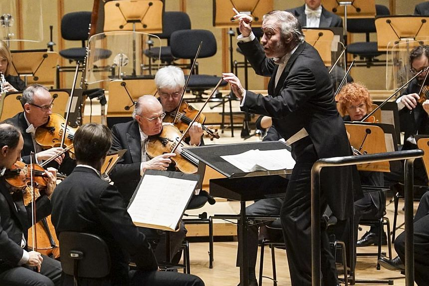 Principal conductor Valery Gergiev (centre) and the London Symphony Orchestra (LSO)performing at the Esplanade Concert Hall on Thursday, Nov 20.On Thursday, the second night of their Singapore stopover, principal conductor Valery Gergiev