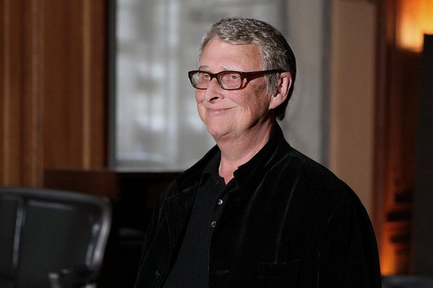 Film director Mike Nichols poses in Paris, during a photocall for his new movie Charlie Wilson's War in France on Jan 11, 2008. -- PHOTO: AFP