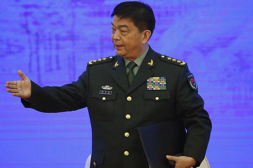 China's Defence Minister Chang Wanquan gestures after he delivered a speech during a security forum attended by senior officials and academics from Central Asia and the Asia-Pacific, in Beijing on Nov 21, 2014. -- PHOTO: REUTERS