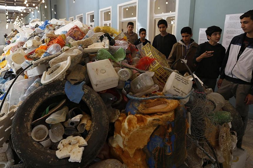 Jordanian students tour the plastic waste exhibition Sea, The Last Leg in downtown Amman Nov 19, 2014.EU governments unanimously approved a new law to slash the use of plastic grocery bags on Friday, hoping to curb litter on land and a spreadin