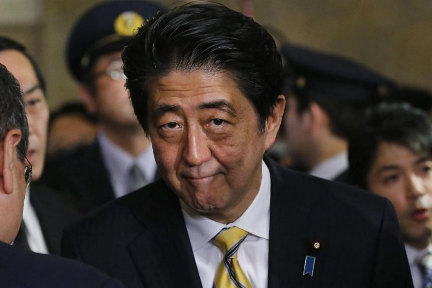 Only 39 per cent of those polled by the Asahi Shimbun daily in a poll conducted Nov 18 to Nov 19 said they supported Mr Abe, down 3 percentage points from a survey done earlier this month. -- PHOTO: REUTERS