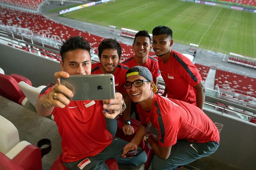 Shahril Ishak takes a selfie with his teammates in the VIP stands as they tour the Sports Hub.-- ST PHOTO:KUA CHEE SIONG