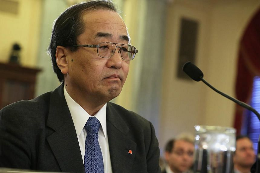 Senior Takata executive Hiroshi Shimizu (above) on Thursday defended the embattled Japanese auto parts firm's actions before a US Senate panel investigating an airbag fault tied to several deaths and hundreds of injuries. -- PHOTO: AFP