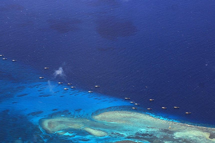 This handout file photo taken on July 17, 2012 and released by the Philippine military's Western Command shows Chinese fishing vessels anchored at Fiery Cross Reef (Kagitingan) on the disputed Spratly islands. -- PHOTO: AFP