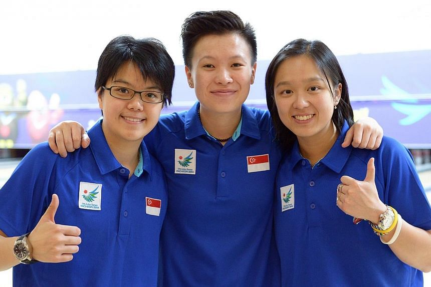 Singapore bowlers (from left) Cherie Tan, New Hui Fen and Jazreel Tan at Anyang Hogye Gymnasium in Incheon, South Korea, on Sept 28, 2014. Cherie Tan came out tops in the women's Open of the It's Daejeon International Open on Saturday. -- PHOTO: ST F