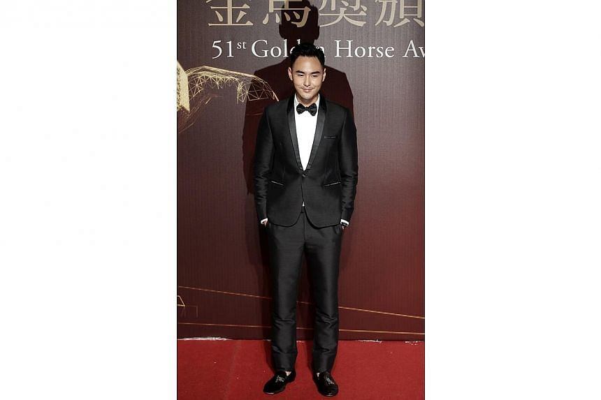 Taiwanese actor Ethan Juan poses for photographers on the red carpet at the 51st Golden Horse Film Awards in Taipei on Nov 22, 2014. -- PHOTO: REUTERS