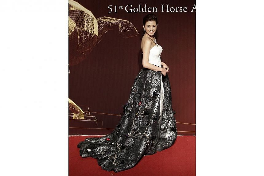 Chinese actress Wan Qian poses for photographers on the red carpet at the 51st Golden Horse Film Awards in Taipei on Nov 22, 2014. -- PHOTO: REUTERS