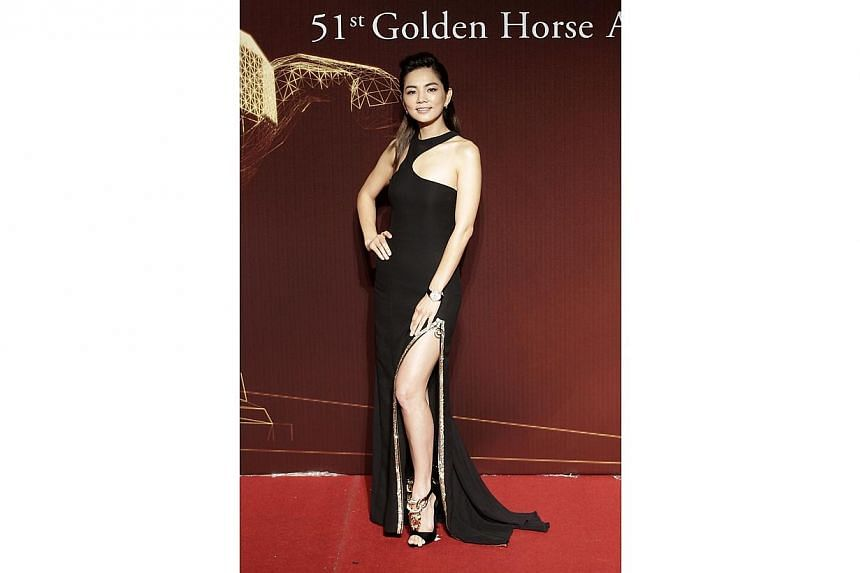 Taiwanese actress and singer Ella from Taiwan music group S.H.E. poses on the red carpet at the 51st Golden Horse Film Awards in Taipei on Nov 22, 2014. -- PHOTO: REUTERS