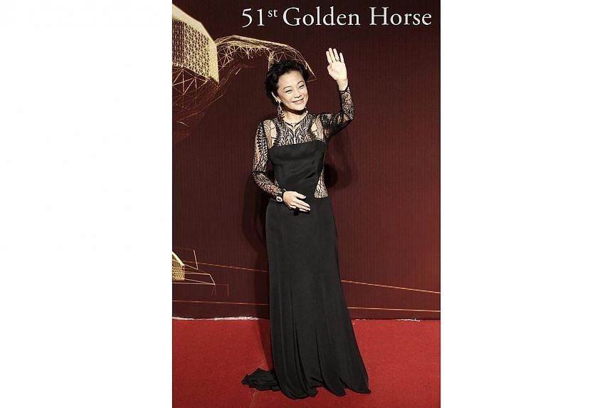 Actress Sylvia Chang waves on the red carpet at the 51st Golden Horse Film Awards in Taipei on Nov 22, 2014. -- PHOTO: REUTERS