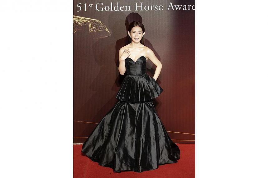 Taiwanese actress and singer Kuo Shu-yau poses for photographers on the red carpet at the 51st Golden Horse Film Awards in Taipei on Nov 22, 2014. -- PHOTO: REUTERS