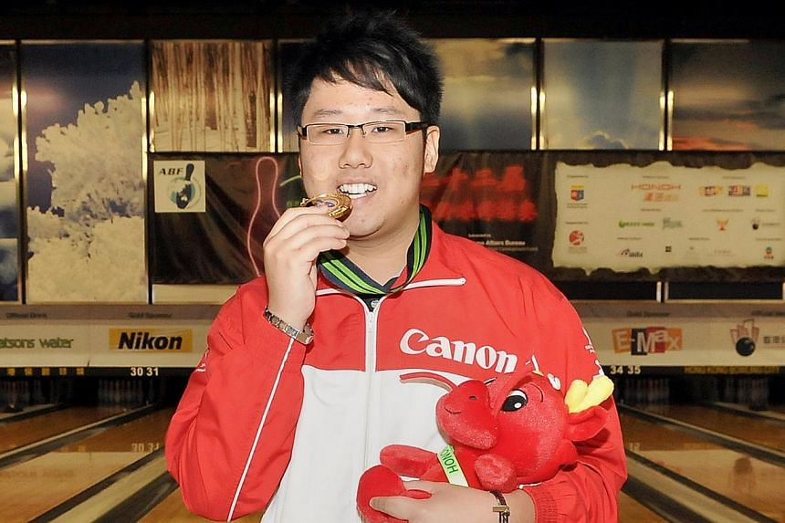 This photo shows Keith Saw clinching his first major bowling honour in 2012, winning the men's singles title at the 22nd Asian Tenpin Bowling Championships in Hong Kong. The bowler has won his first national title on Saturday, when he came out tops